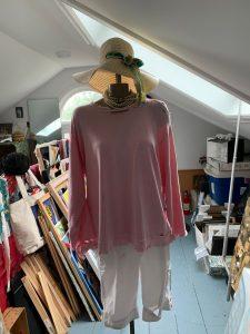 pink sweatshirt pearls shorts hat